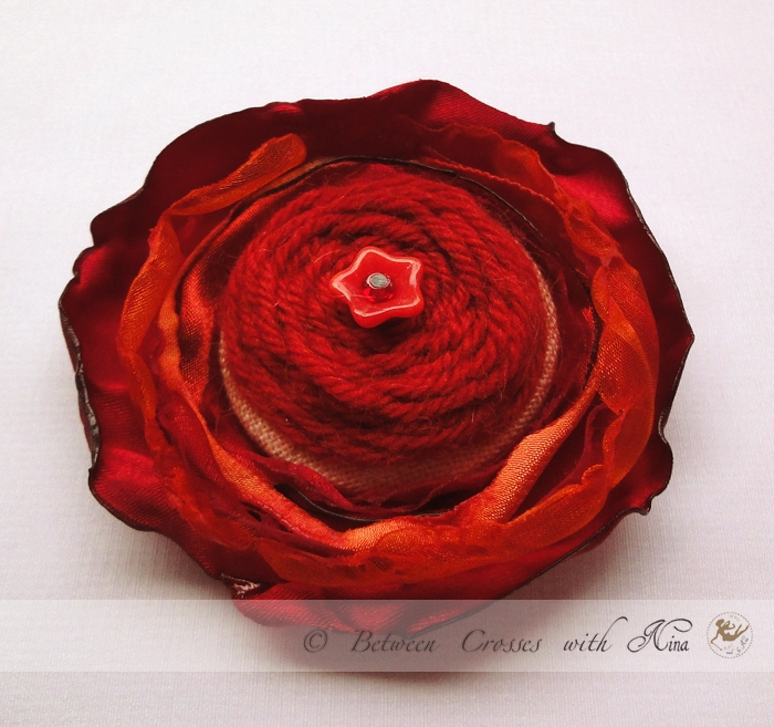 red brooch_by Nina